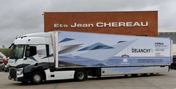 A refrigerated semi-trailer with the DELANCHY logo, parked in front of the CHEREAU establishments.