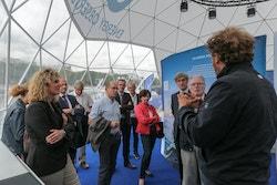 A delegation of Thélem assurances visiting the Energy Observer village with Jérôme Delafosse in Paris in 2017
