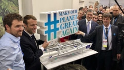 Victorien, Emmanuel Macron and Nicolas Hulot standing next to the Energy Observer's replica