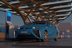 Un visuel 3D représentant une voiture s'arretant à une station hydrogène