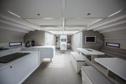 The interior of the central gondola with the kitchen on the left, the monitoring in the middle and the workspace on the right