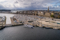 UAV picture with Energy Observer moored and the city of Saint-Malo in the background
