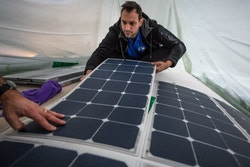 Hugo installs solar panels on the boat