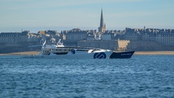 Energy Observer sails with the city of Saint-Malo in the background