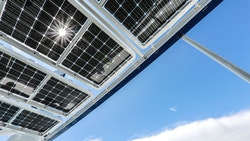 Energy Observer's bifacial solar panels with the sun's reflection