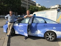 Victorien et Jérôme next to an Hype Taxi