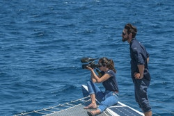Amélie filming from the boat