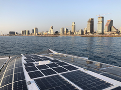 Energy Observer with the city of Tel Aviv in the background