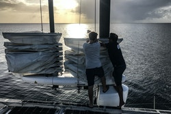Two crew members are doing maintenance on the OceanWings®