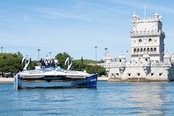Energy Observer skirts the belem tower in Lisbon