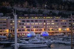The Energy Observer exhibition in front of the port and boats of Monaco