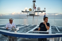 Two crew members on board Energy Observer