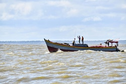 Fishermen at the mouth of the Maroni River
