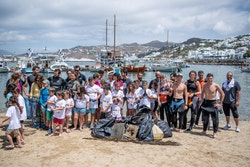 A group of people during a beach cleaning leaning operation