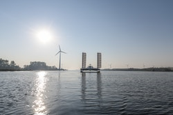 Energy Observer sailing with wind turbine behing